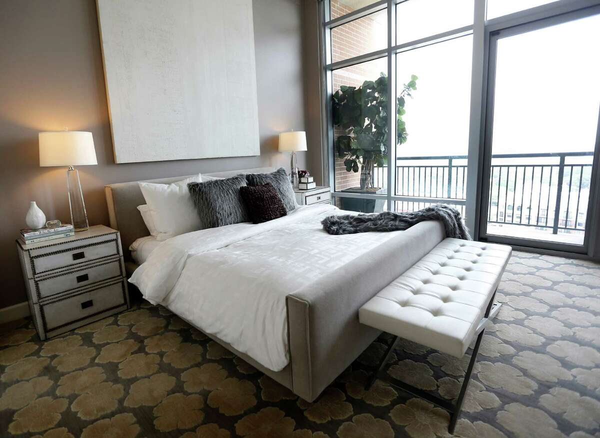 The master bedroom features clean lines with outstanding views out the floor-to-ceiling windows.