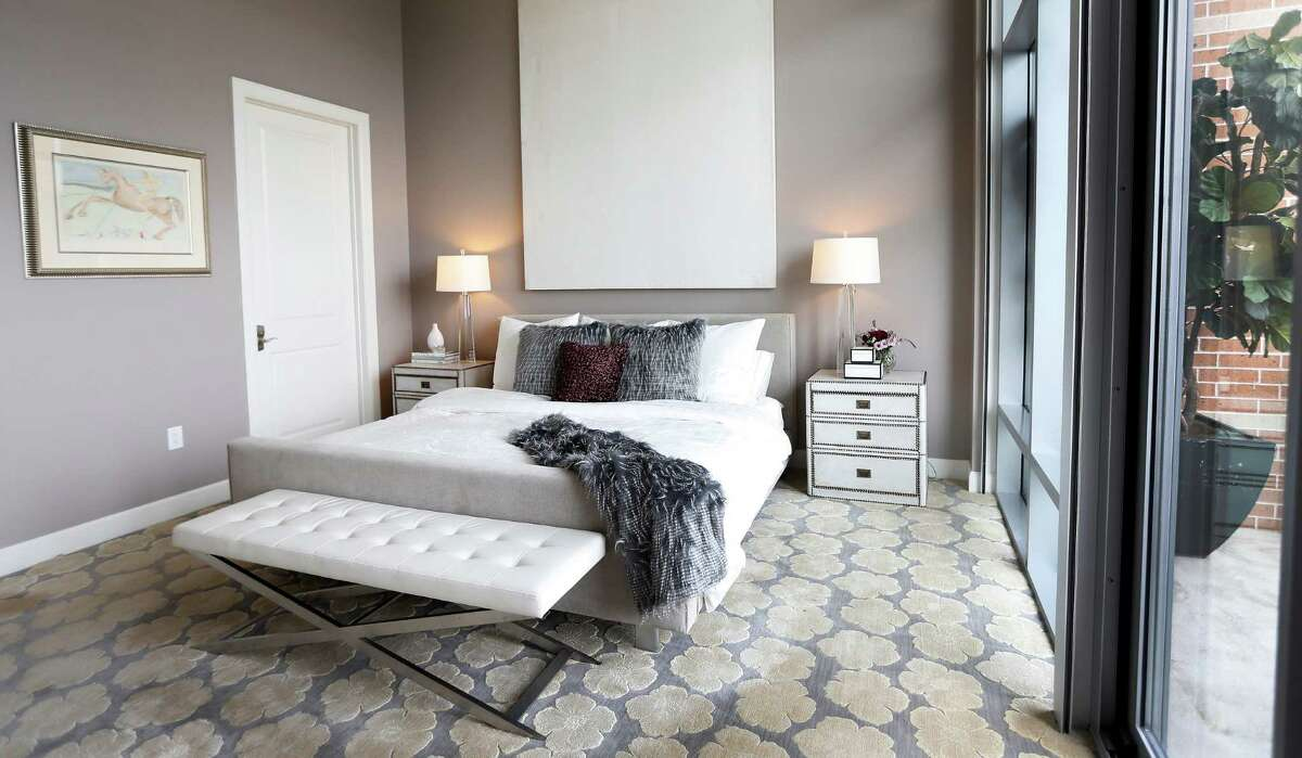 The master bedroom at the home of Doctors Kathy Frazar and Tom Hedge at Highland Tower,Thursday, April 28, 2016, in Houston. The couple moved from a West U home to an inner loop high rise after their daughter left for college. The empty nesters wanted a home with a more modern aesthetic to streamline their busy lifestyle. They've hired an interior designer, Cheryl Baker, and did a substantial remodeling job throughout. ( Karen Warren / Houston Chronicle )