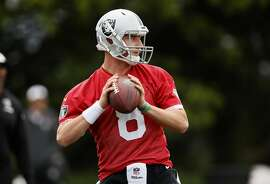Quarterback Connor Cook, 8 during an Oakland Raiders NFL mini-camp at their training facility in Alameda, California, on May 13,2016.