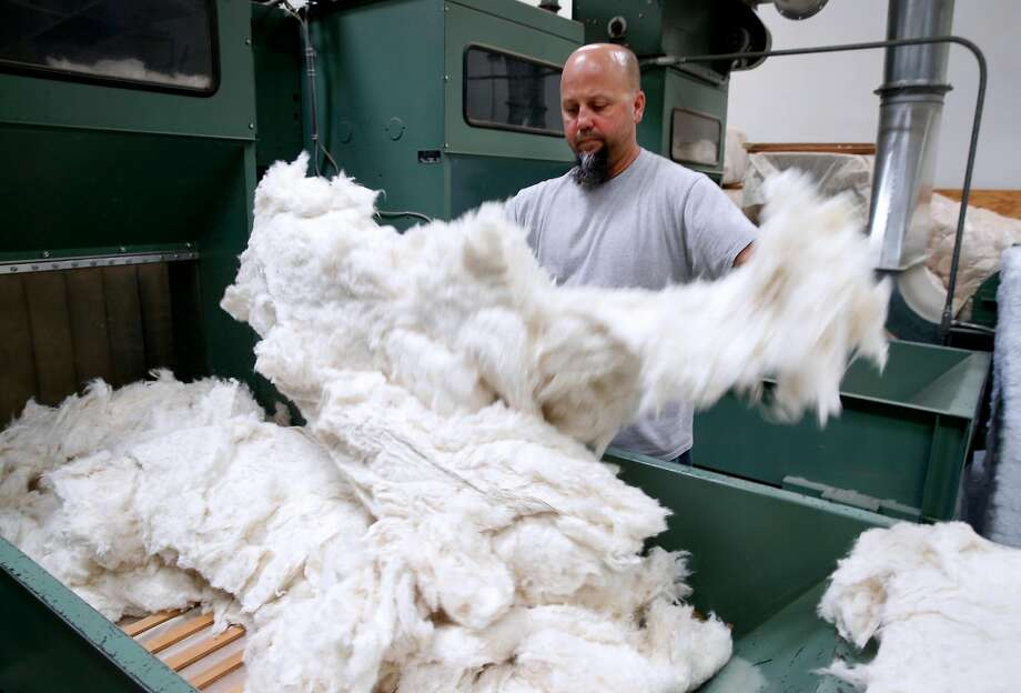 Ed Rahmer prepares cotton material at McRoskey Mattress Co. in Dogpatch. Photo: Paul Chinn, The Chronicle
