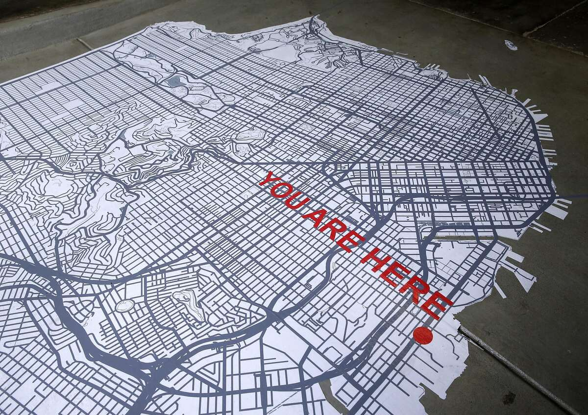 A map of the city on the floor welcomes customers to Poco Dolce chocolatier in San Francisco, Calif. on Friday, May 13, 2016.