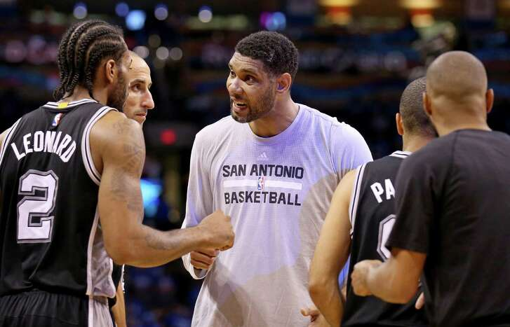 Spurs' Tim Duncan talks with Kawhi Leonard, Manu Ginobili, and Tony Parker during a timeout in second half action of Game 6 in the Western Conference semifinals against the Thunder on May 12, 2016 at Chesapeake Energy Arena in Oklahoma City.