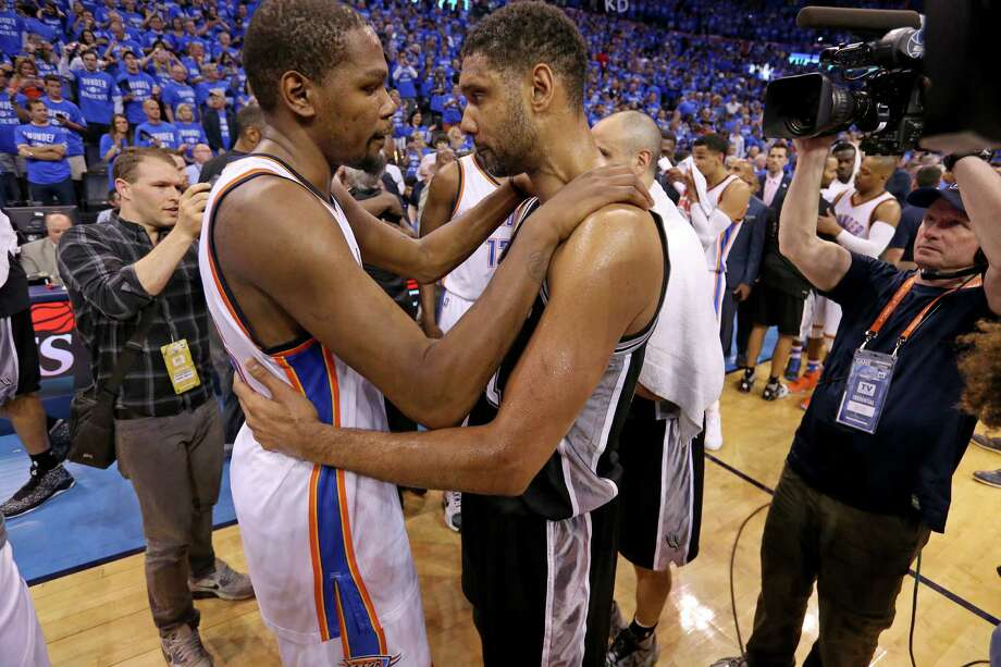 Oklahoma City Thunder's Kevin Durant and the Spurs' Tim Duncan talk after Game 6 in the Western Conference semifinals on May 12, 2016 at Chesapeake Energy Arena. Photo: Edward A. Ornelas /San Antonio Express-News / © 2016 San Antonio Express-News