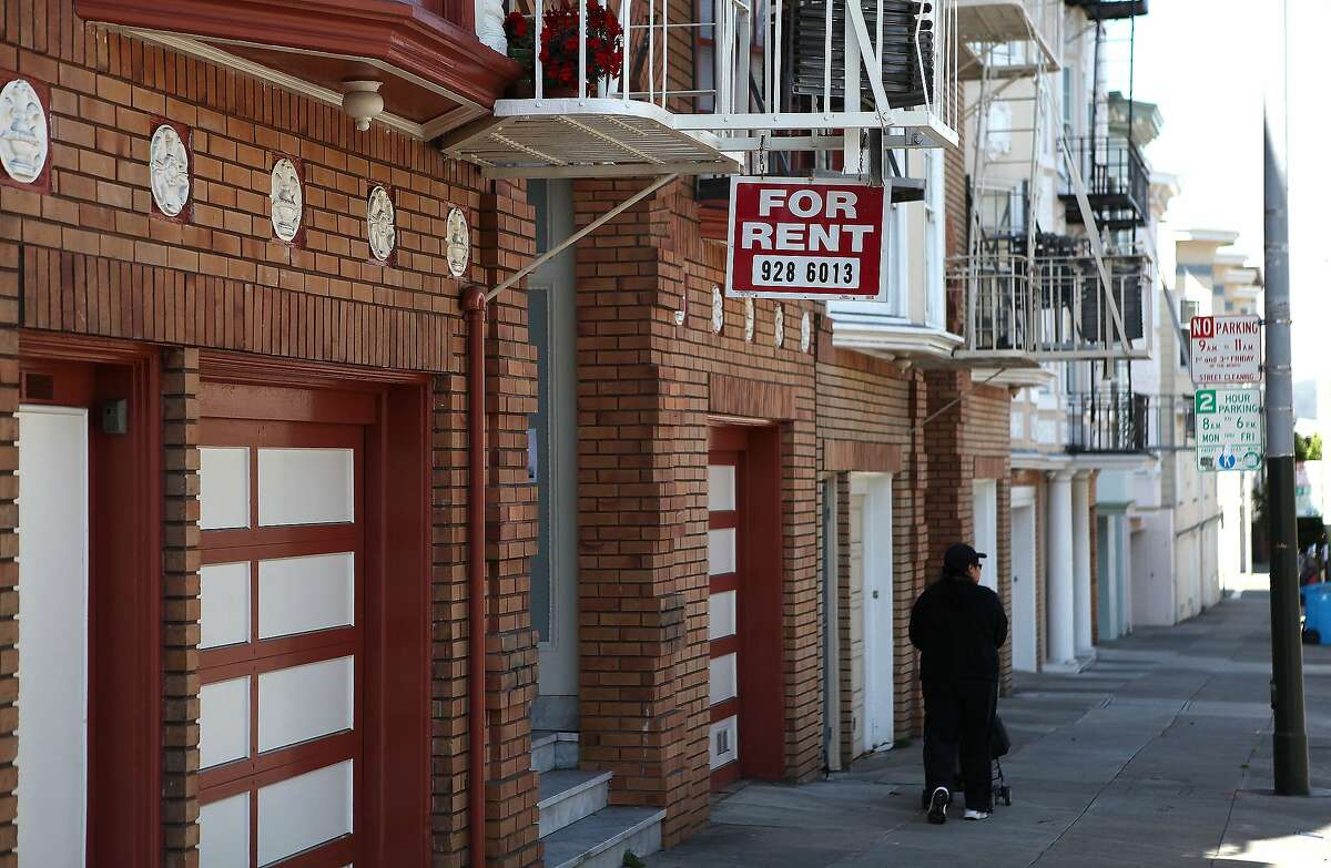 Old school rental ad : A sign advertising an apartment for rent hangs from a fire escape in front of an apartment building in this file photo. A new rental service launching Tuesday in the Bay Area allows prospective tenants to bid online for apartments.