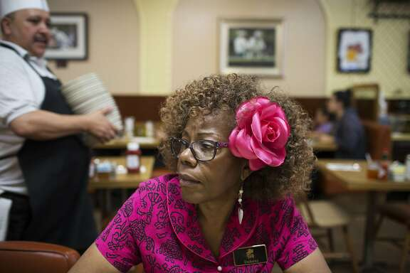 "Dolores Jeanpierre takes her 8 am break at Ole's Waffle Shop on Friday, May 13, 2016 in Alameda, Calif. In her 37th year working at the diner, Jeanpierre arrives at the restaurant several days a week around 4:30 am to open up. ""Your body gets used to it,"" she said."
