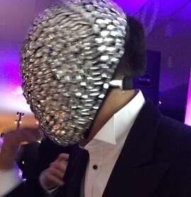 Man with mirror face dances at Modern Ball