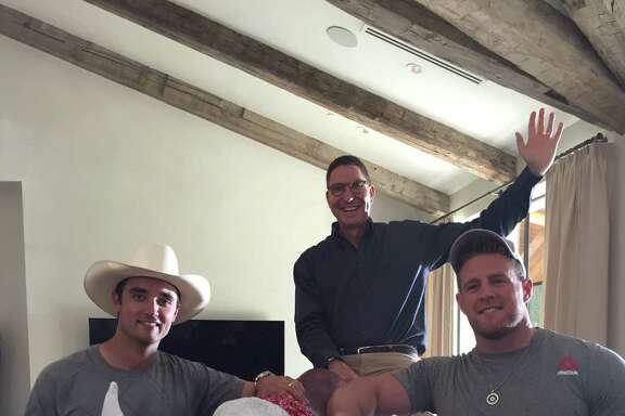 Texans quarterback Brock Osweiler,from left, H-E-B supermarket president Scott McClelland andTexans superstar J.J. Watt have filmed four new TV spots.