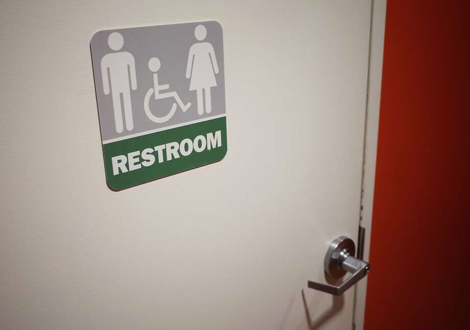 "(FILES) This file photo taken on May 5, 2016 shows a gender neutral bathroom at a restaurant in Washington, DC. President Barack Obama's administration fired the latest salvo May 13, 2016 in a heated battle over the rights of transgender Americans, telling schools they must allow students to use bathrooms of their choosing.In a letter to school districts and universities, officials from the Justice and Education Departments outlined how to prevent discrimination against transgender students and what Attorney General Loretta Lynch described as ""unjust"" school policies.  / AFP PHOTO / MANDEL NGANMANDEL NGAN/AFP/Getty Images Photo: MANDEL NGAN, AFP/Getty Images"