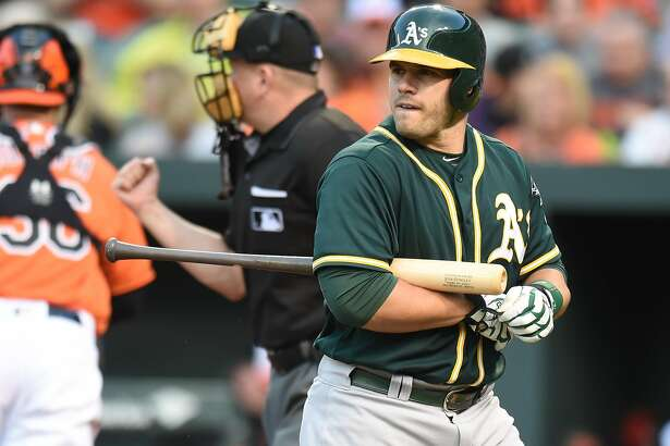 BALTIMORE, MD - MAY 7:  Josh Phegley #19 of the Oakland Athletics Walk back to the dug out after striking out in the second inning during game two of a double header baseball game against the Baltimore Orioles at Oriole Park at Camden Yards on May 7, 2016 in Baltimore, Maryland.  (Photo by Mitchell Layton/Getty Images)