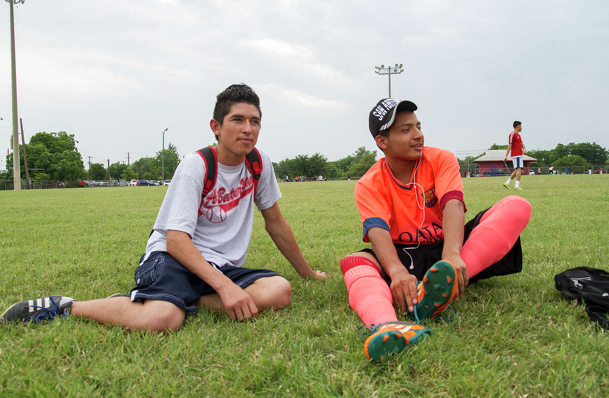 Edwin (left) and Braulio wait to play a soccer game at Cuellar Park. They live at Posada Guadalupe, a shelter for young immigrant men working to gain legal status. The nonprofit ministry operates mostly on donations and small grants.