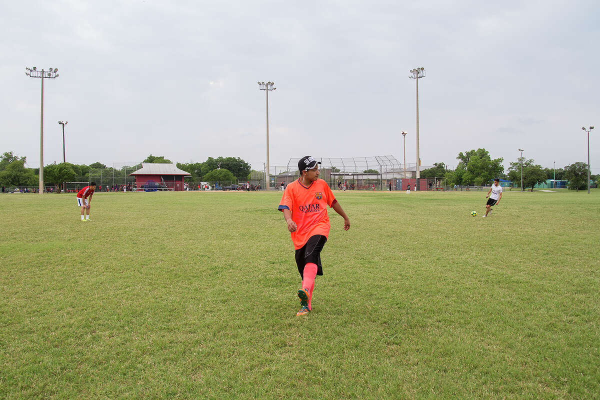 Braulio getting ready to play soccer at Cuellar Park, Thursday, May 12, 2016. Braulio lives at Posada Guadalupe, a shelter for young immigrant men working to gain legal status.