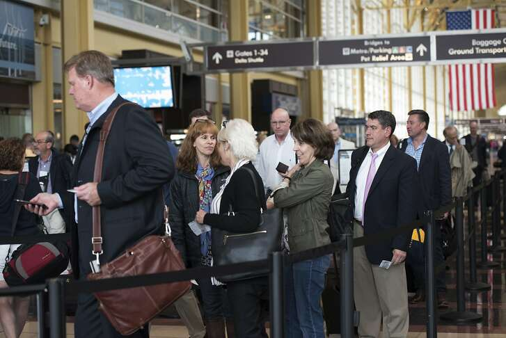 Passengers wait in a security line at Washington's Ronald Reagan National Airport in Washington, Friday, May 13, 2016.  Fliers across the country have been facing growing lines, which during peak hours have topped 90 minutes at some airports. The TSA has fewer screeners and has tightened security procedures. Meanwhile, more people are flying.  (AP Photo/Sait Serkan Gurbuz)