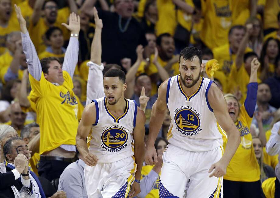 Stephen Curry and Andrew Bogut, heading upcourt after a basket in the Portland series, have chemistry on court. Photo: Marcio Jose Sanchez, Associated Press