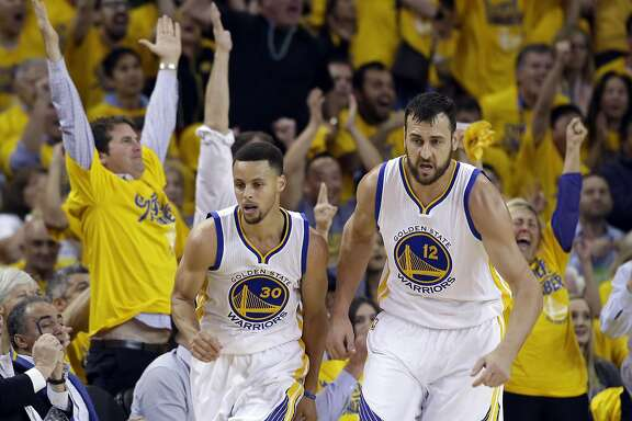 Golden State Warriors' Stephen Curry celebrates after scoring alongside teammate Andrew Bogut against the Portland Trail Blazers during the first half in Game 5 of a second-round NBA basketball playoff series Wednesday, May 11, 2016, in Oakland, Calif. (AP Photo/Marcio Jose Sanchez)