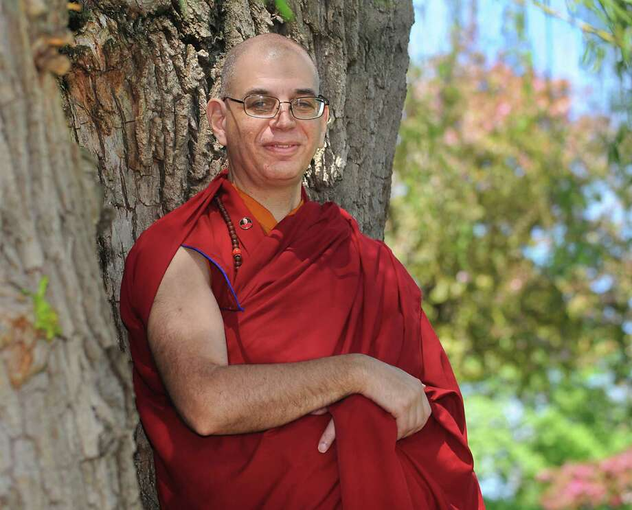 Lama Zopa, teacher of the Albany KTC Buddhist center, stands under a tree outside his home on Tuesday, May 10, 2016 in Menands, N.Y. (Lori Van Buren / Times Union) Photo: Lori Van Buren / 20036539A