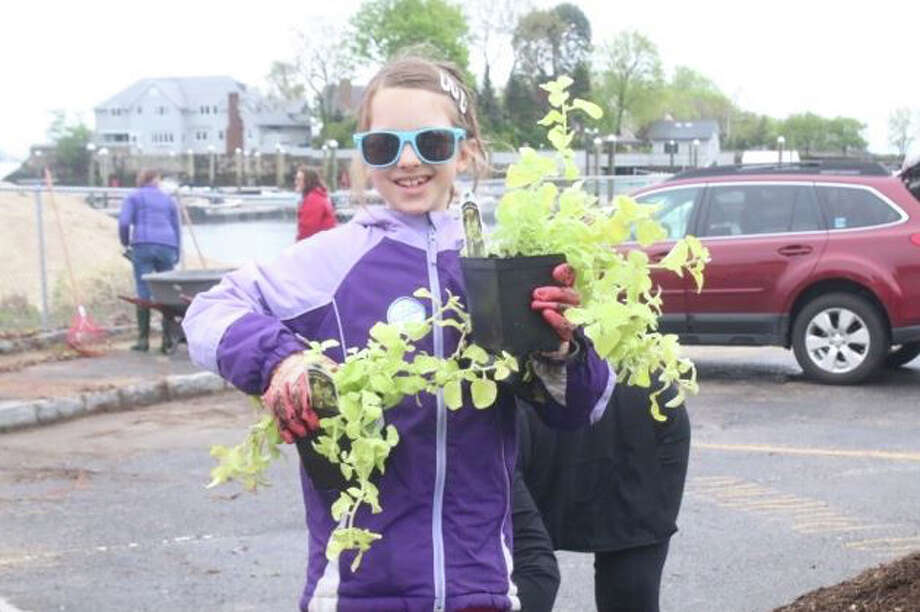 Imogen Buck was among the many residents who volunteered their time to spruce up Byram Park last week in anticipation of the summer season. Photo: Mellana, Thomas