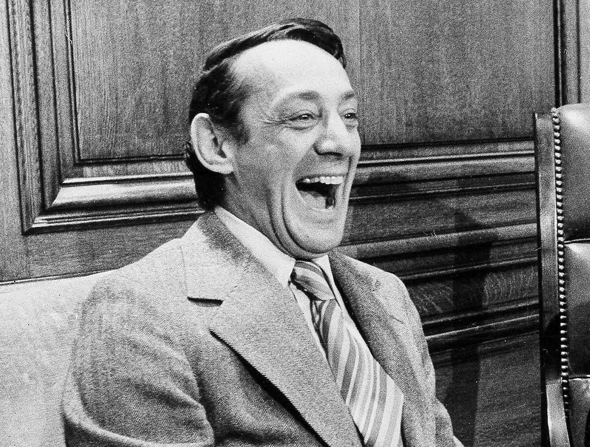 FILE - This file photo from April 1977 shows San Francisco Supervisor Harvey Milk in the mayor's office during the signing of the city's gay rights bill in San Francisco. A proposal to name a street after pioneering gay leader Harvey Milk is the latest display of Salt Lake City standing out as a blue dot in a deep-red state where the prevailing Mormon faith still has a fraught relationship with the LGBT community. (AP Photo/File)