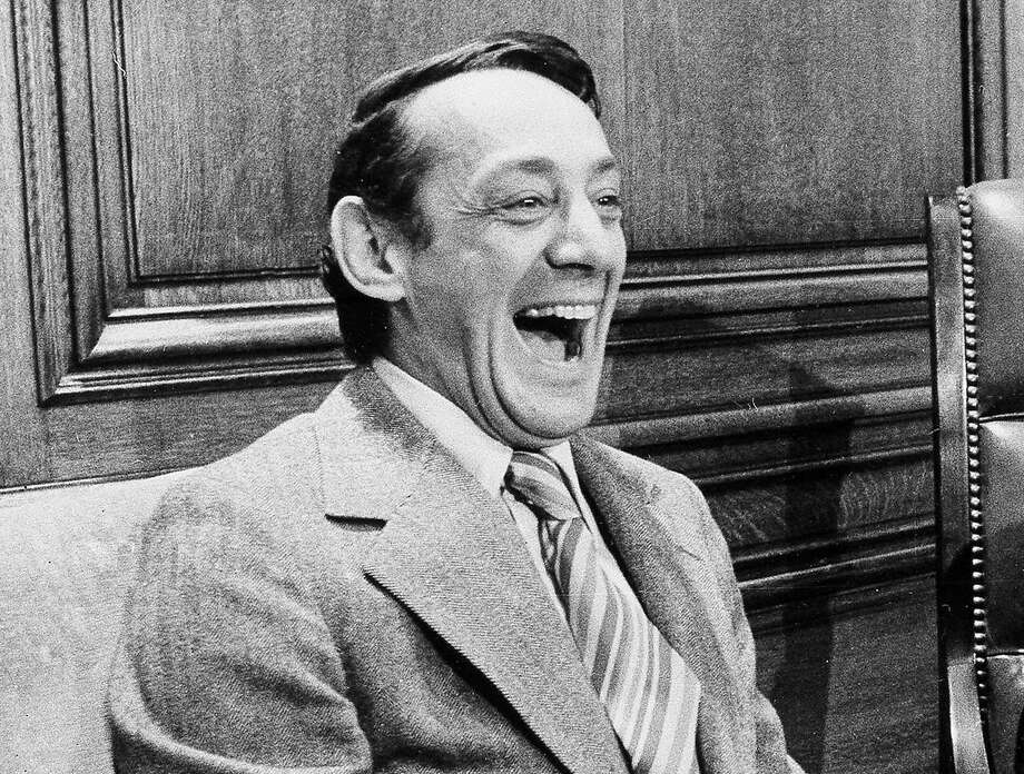 FILE - This file photo from April 1977 shows San Francisco Supervisor Harvey Milk in the mayor's office during the signing of the city's gay rights bill in San Francisco. A proposal to name a street after pioneering gay leader Harvey Milk is the latest display of Salt Lake City standing out as a blue dot in a deep-red state where the prevailing Mormon faith still has a fraught relationship with the LGBT community. (AP Photo/File) Photo: STF, Associated Press