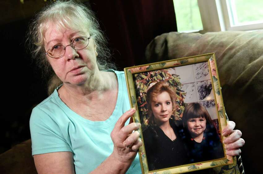 Shirley Olmsted holds a picture of her daughter, Audrey Herron, on Friday, May 13, 2016, in Hannacroix, N.Y. In this 1996 picture, Herron is with her daughter Sonsia Court, who was 4 years old at the time. Herron has been missing since 2002. (Cindy Schultz / Times Union)