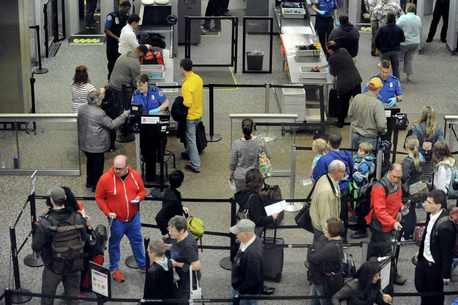 Airline passengers wait in line to go through TSA screening on Friday, April 8, 2016, at the Albany International Airport in Colonie, N.Y. (Cindy Schultz / Times Union) Photo: Cindy Schultz / Albany Times Union