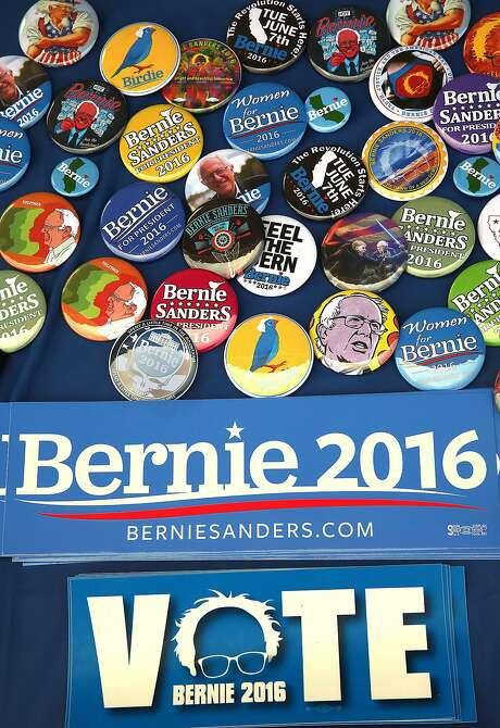 Buttons and bumper stickers made in San Leandro by volunteers  dress the Bernie Sanders for President table in front of the Pioneer Bookstore at California State University, East Bay campus in Hayward, California, on thursday, may 13, 2016. Photo: Liz Hafalia, The Chronicle