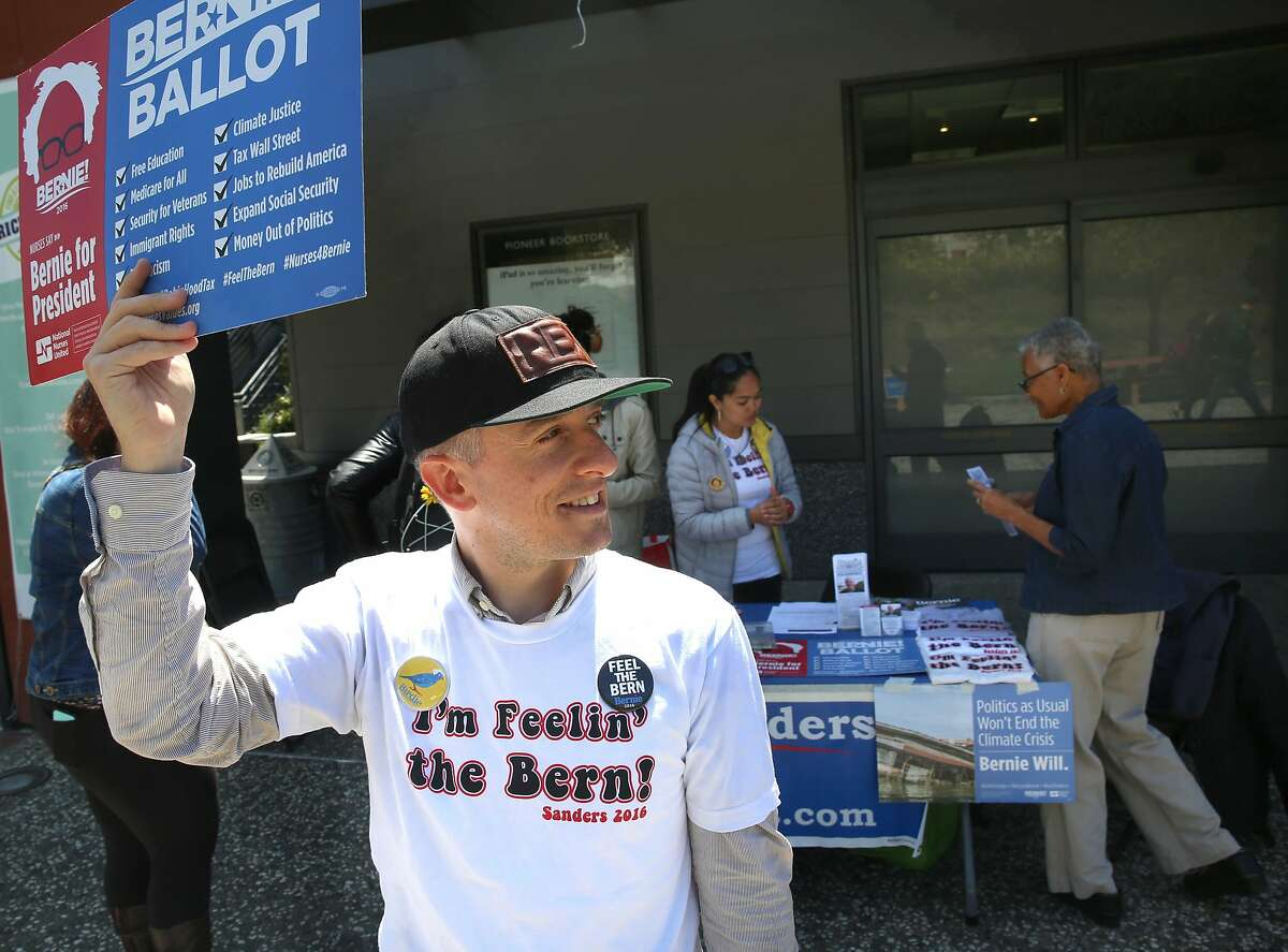 Volunteer Steve Davis from San Lorenzo for Bernie works the Bernie Sanders for President table at the California State University, East Bay campus in Hayward, California, on thursday, may 13, 2016.