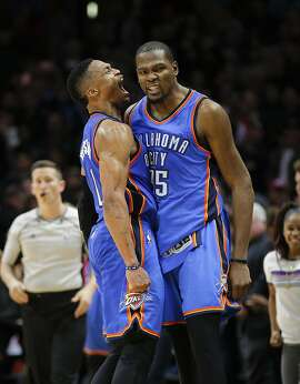 Oklahoma City Thunder's Kevin Durant, right, and Russell Westbrook celebrate their team's 100-99 win over the Los Angeles Clippers in an NBA basketball game, Monday, Dec. 21, 2015, in Los Angeles. (AP Photo/Jae C. Hong)