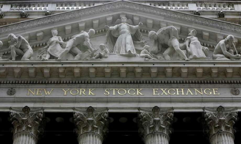 FILE - This Thursday, Oct. 2, 2014, file photo, shows the facade of the New York Stock Exchange. Stock markets around the world and oil prices were weighed down Friday, May 13, 2016, by concerns over the global economy ahead of a raft of U.S. and Chinese economic data. (AP Photo/Richard Drew, File) ORG XMIT: NYBZ565 Photo: Richard Drew / Copyright 2016 The Associated Press. All rights reserved. This m