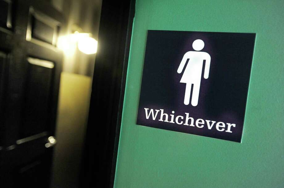 A gender neutral sign is posted outside a bathroom at Oval Park Grill in Durham, N.C. (Photo by Sara D. Davis/Getty Images) Photo: Sara D. Davis, Stringer / 2016 Getty Images