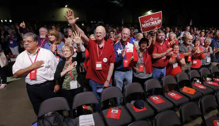 Delegates cheer after the national anthem Thursday at the Republican Party of Texas State Convention in Dallas.  (Rodger Mallison / Fort Worth Star-Telegram)