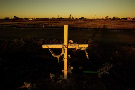 A memorial cross is planted in West near the spot where 15 people died, including a dozen firefighters who raced in unaware of the dangers at the plant.