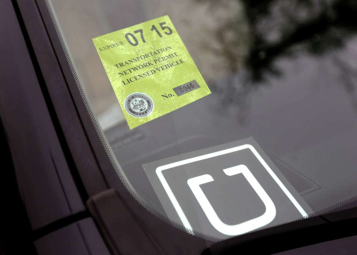 A Transportation Network Company vehicle for hire license permit is installed at the Kashmere Multi-Service Center on Nov. 6, 2014, in Houston. It was the first day for citywide regulations allowing Uber drivers to legally operate.