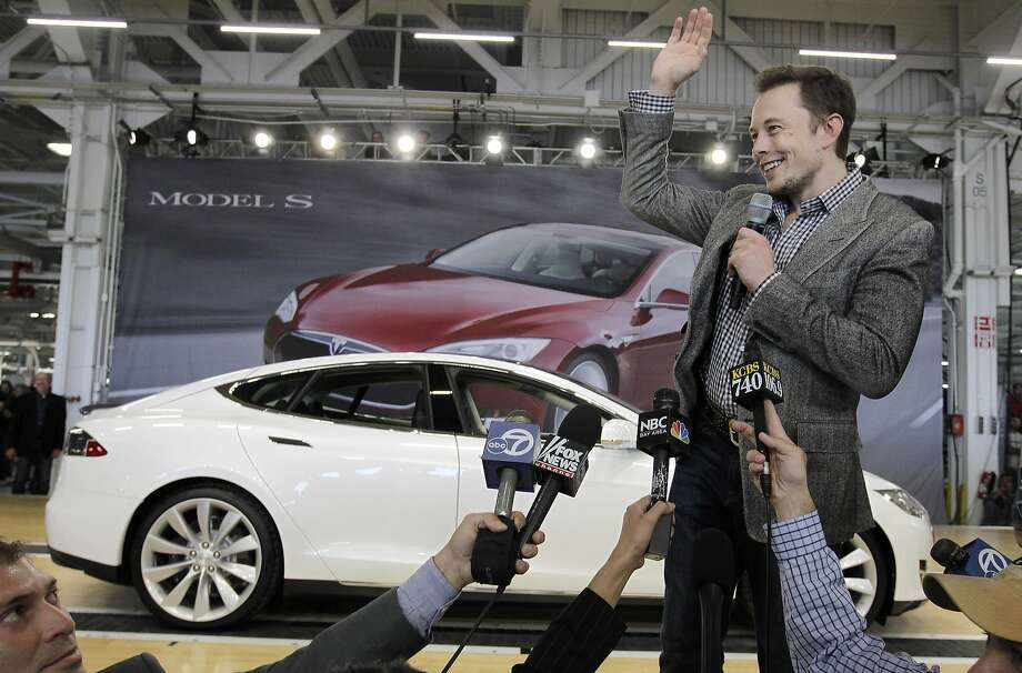 FILE - In this June 22, 2012 file photo, Tesla CEO Elon Musk waves during a rally at the Tesla factory in Fremont, Calif. Musk has five states bidding up subsidy packages to land a coveted plant for a $5 billion factory to make batteries for a new generation of Tesla electric cars. (AP Photo/Paul Sakuma, File) Photo: Paul Sakuma, Associated Press