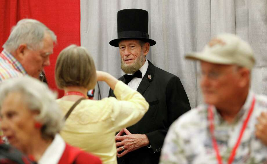Abe Lincoln, portayed by Courtland Savage, was a promotional guest of the Ted Cruz booth Friday for the second day of the Republican Party of Texas state convention in Dallas. A point of contention for delegates was whether to include secession from the United States in the party's platform. Photo: Paul Moseley, MBR / Fort Worth Star-Telegram