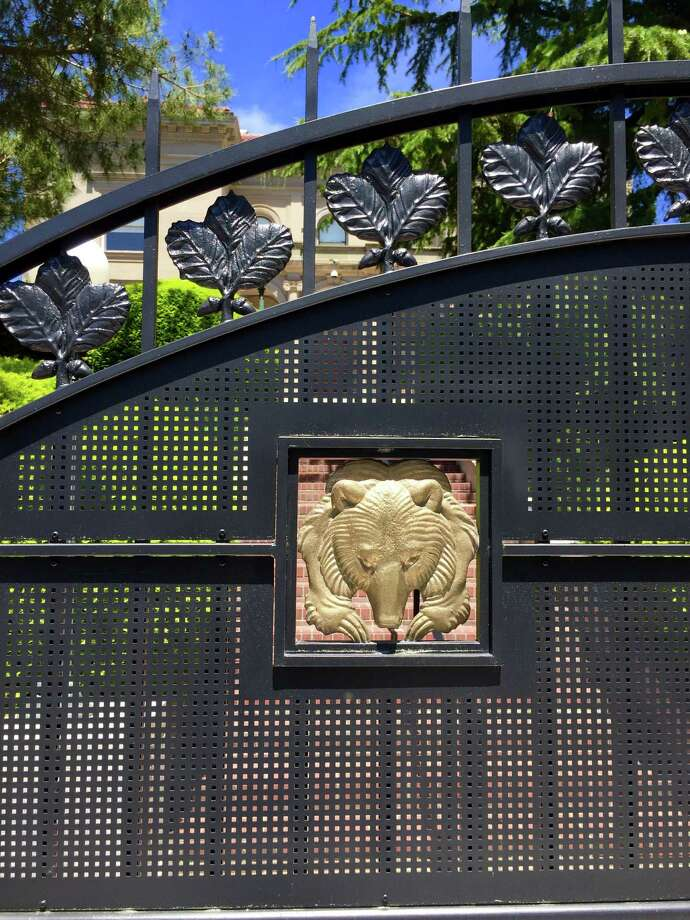 A golden bear adorns the gate of a new fence surrounding UC Berkeley Chancellor Nicholas Dirks' campus home. Photo: Andy Ross / Andy Ross / The Chronicle