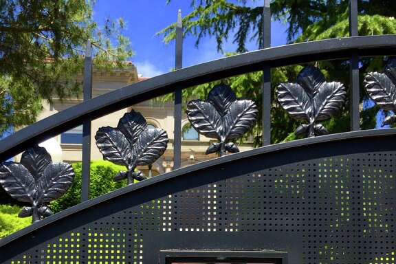 A golden bear adorns the gate of a new fence surrounding UC Berkeley Chancellor Nicholas Dirks' campus home.