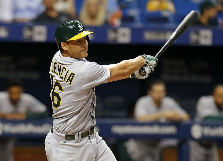 Oakland Athletics' Danny Valencia follows through on his home run during the sixth inning of a baseball game against the Tampa Bay Rays, Friday, May 13, 2016, in St. Petersburg, Fla. (AP Photo/Mike Carlson) Photo: Mike Carlson, Associated Press