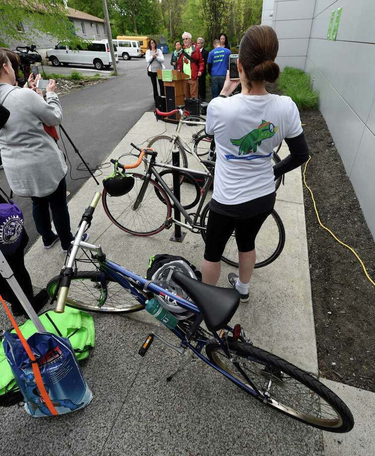 Bicycle enthusiasts rally at the newly installed bicycle service station outside the Henry Johnson Blvd. Albany Public Library branch on Friday morning, May 13, 2016, in Albany, N.Y. (Skip Dickstein/Times Union) Photo: SKIP DICKSTEIN / 20036465A