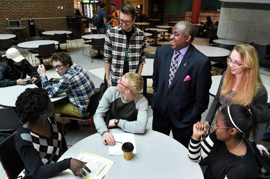 SCCC President Steady Moono, third from right, talks with students on Wednesday, March 23, 2016, at Schenectady County Community College in Schenectady, N.Y. Joining him, from left, are Shantal Plass, 26, Nathan Mueller, 21, Joseph McDade, 19, Micaelyn Ketchen, 19, and Tatiana Ragbeer, 18. Moono is raising money to launch a minority mentorship program in the fall that would pair black and Latino students with a mentor to help keep them on track. (Cindy Schultz / Times Union) Photo: Cindy Schultz / Albany Times Union