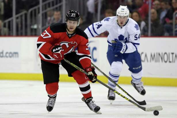 NEWARK, NJ - APRIL 9: Pavel Zacha #37 of the New Jersey Devils in action against the Toronto Maple Leafs during the second period at the Prudential Center on April 9, 2016 in Newark, New Jersey. (Photo by Adam Hunger/Getty Images) ORG XMIT: 574716087