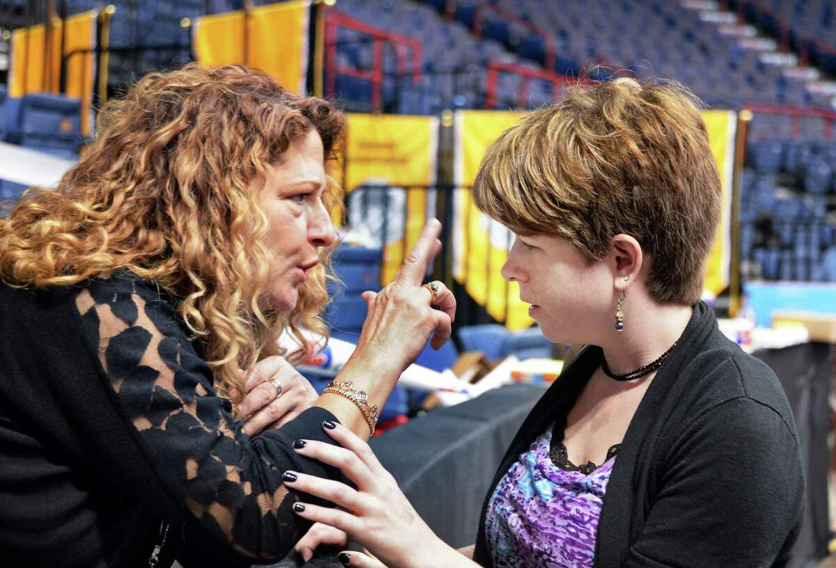 Blind and deaf, Quinn Burch, of Rotterdam, right, who will graduate with her class from the College of St. Rose and her mother Peg Burch at the Times Union Center for a run through of tomorrow's graduation walk Friday May 13, 2016 in Albany, NY. (John Carl D'Annibale / Times Union)