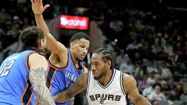 San Antonio Spurs' Kawhi Leonard looks for room between Oklahoma City Thunder's Andre Roberson and Steven Adams during second half action of Game 5 in the Western Conference semifinals Tuesday May 10, 2016 at the AT&T Center. The Thunder won 95-91.