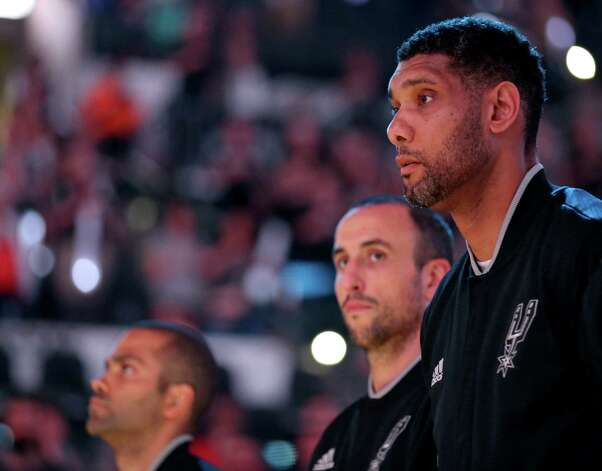 San Antonio Spurs' Tony Parker (from left), Manu Ginobili, and Tim Duncan stand during the national anthem before Game 5 in the Western Conference semifinals against the Oklahoma City Thunder Tuesday May 10, 2016 at the AT&T Center. Photo: Edward A. Ornelas, Staff / San Antonio Express-News / © 2016 San Antonio Express-News