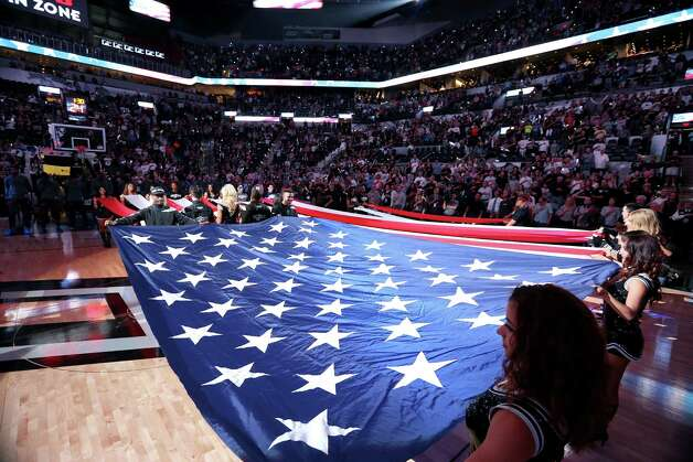 Members of the San Antonio Spurs Silver Dancers and Team Energy hold an American flag during the national anthem before Game 5 in the Western Conference semifinals between the San Antonio Spurs and Oklahoma City Thunder Tuesday May 10, 2016 at the AT&T Center. Photo: Edward A. Ornelas, Staff / San Antonio Express-News / © 2016 San Antonio Express-News