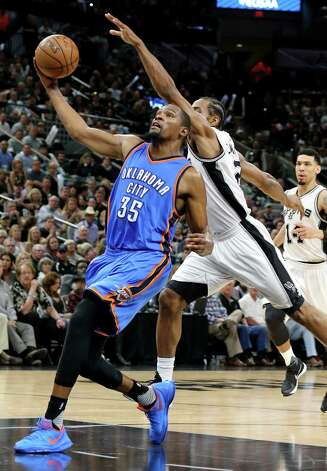 Oklahoma City Thunder's Kevin Durant drives to the basket around San Antonio Spurs' Kawhi Leonard during first half action of Game 5 in the Western Conference semifinals Tuesday May 10, 2016 at the AT&T Center. Durant was fouled by Leonard on the play. Photo: Edward A. Ornelas, Staff / San Antonio Express-News / © 2016 San Antonio Express-News