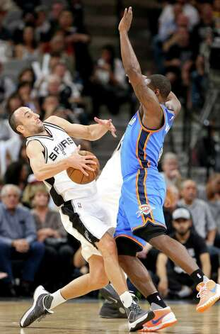 San Antonio Spurs' Manu Ginobili is fouled by Oklahoma City Thunder's Dion Waiters during first half action of Game 5 in the Western Conference semifinals Tuesday May 10, 2016 at the AT&T Center. Photo: Edward A. Ornelas, Staff / San Antonio Express-News / © 2016 San Antonio Express-News