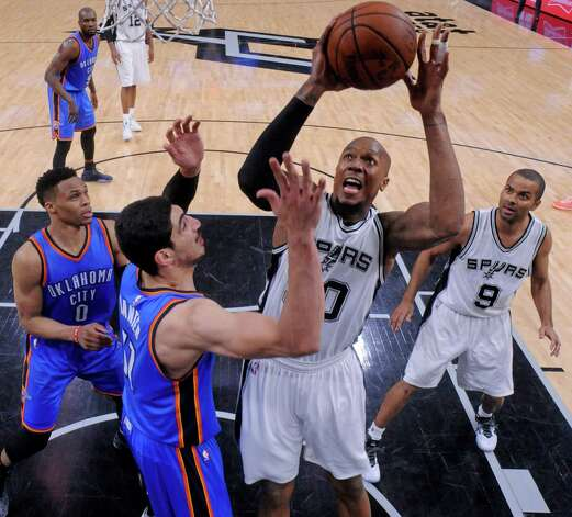San Antonio Spurs' David West shoots over Oklahoma City Thunder's Enes Kanter and Russell Westbrook (left) and San Antonio Spurs' Tony Parker look on during Game 5 in the Western Conference semifinals Tuesday May 10, 2016 at the AT&T Center. The Thunder won 95-91. Photo: Edward A. Ornelas, Staff / San Antonio Express-News / © 2016 San Antonio Express-News