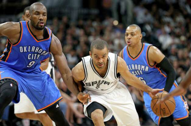 San Antonio Spurs' Tony Parker drives around Oklahoma City Thunder's Serge Ibaka during second half action of Game 5 in the Western Conference semifinals Tuesday May 10, 2016 at the AT&T Center. The Thunder won 95-91. Photo: Edward A. Ornelas, Staff / San Antonio Express-News / © 2016 San Antonio Express-News