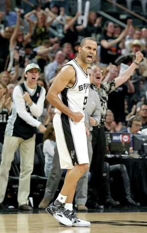 San Antonio Spurs' Tony Parker celebrates after a basket on a pass from San Antonio Spurs' LaMarcus Aldridge during second half action of Game 5 in the Western Conference semifinals against the Oklahoma City Thunder Tuesday May 10, 2016 at the AT&T Center. The Thunder won 95-91. Photo: Edward A. Ornelas, Staff / San Antonio Express-News / © 2016 San Antonio Express-News