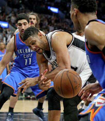 San Antonio Spurs' Tim Duncan grabs for a loose ball between Oklahoma City Thunder's Enes Kanter (left) and Oklahoma City Thunder's Russell Westbrook during second half action of Game 5 in the Western Conference semifinals Tuesday May 10, 2016 at the AT&T Center. The Thunder won 95-91. Photo: Edward A. Ornelas, Staff / San Antonio Express-News / © 2016 San Antonio Express-News
